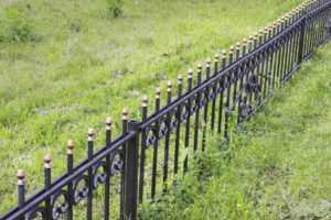 this image shows rio linda fence installation in wrought iron fence
