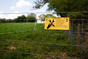 this picture shows an electric fence installation