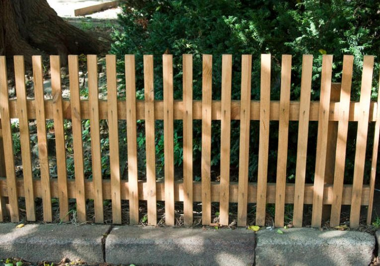 this image shows pine fence installation in Sacramento, California